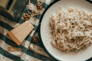 Looking for the Best Comfort food recipes to share with friends and family? We have the best comfort foods from Julia Child's and others! Pasta on plate with rustic tablecloth.